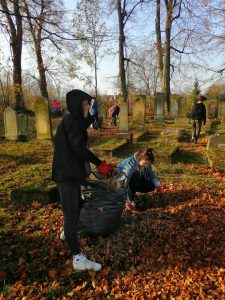 collecting leaves at the cemetery